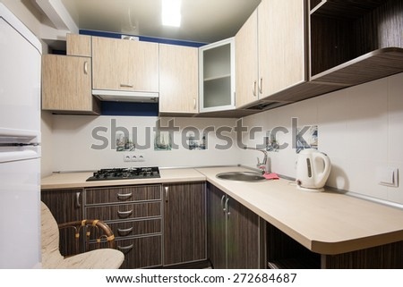 Small kitchenette in a studio, interior lighting