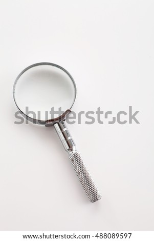small magnifier glass on the white background