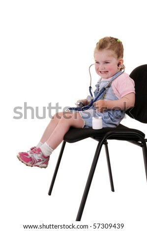 Small playful girl on chair with stethoscope isolated on white background