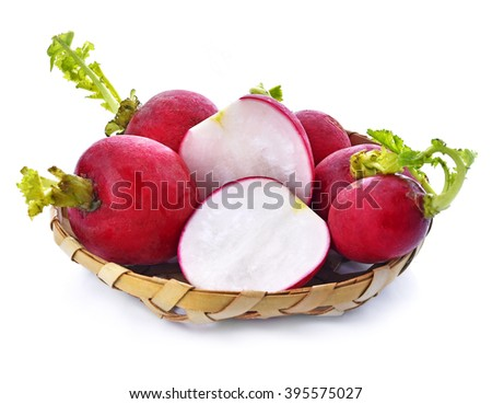 Small radish in basket isolated on white background