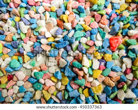 small stone colorful background has red green blue orange yellow white purple color