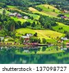 Small town and cruise port Olden in Norwegian fjords. Tourist camping on the beach.  - stock photo