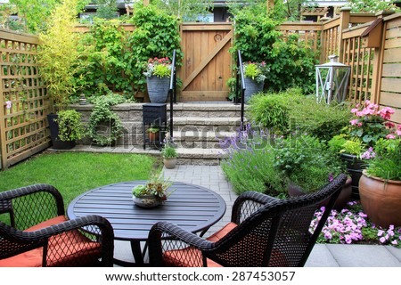 Small Townhouse Garden Patio Furniture Amidst Stock Photo - Townhouse patio