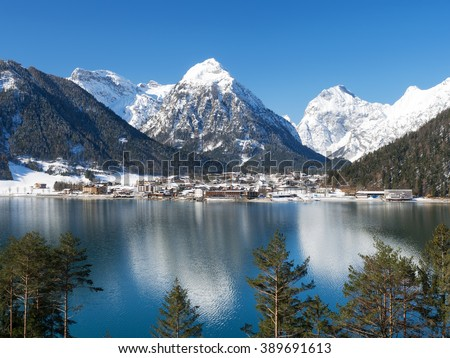 Small village Pertisau at Lake Achensee with snow-covered mountains in the background, Tyrol, Austria