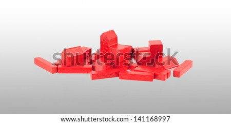 Small wooden building blocks isolated, gradient background