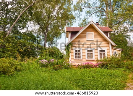 Small wooden house with a front garden in the forest