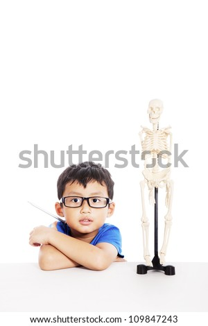 Smart Asian boy with glasses and human skeleton model isolated on white