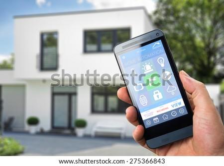 Female Hand Holding Smartphone On Blurred Stock Photo