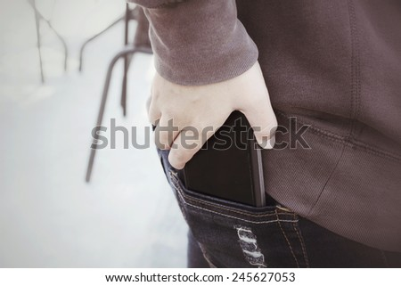 Smart phone in jeans pocket