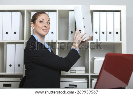 smart secretary puts a folder to the cabinet