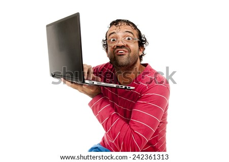 Smart Ugly man with glasses using a laptop