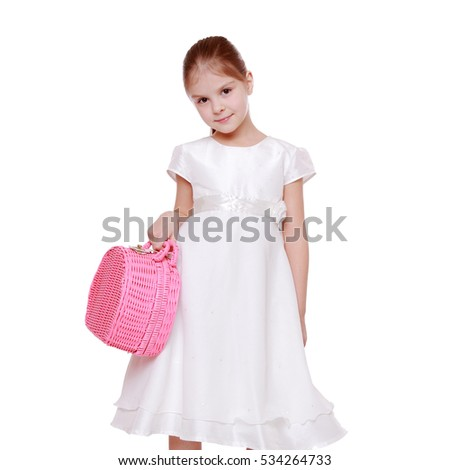 Smiley caucasian sweet little cute girl holding bright pink picnic basket on white background