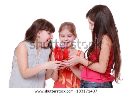 Smiley pretty little girls holding spring flower in pot