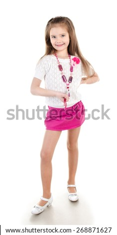 Smiling adorable little girl in skirt with beads isolated on a white