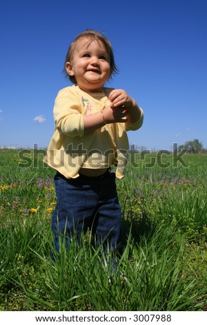 smiling baby girl on windy spring day