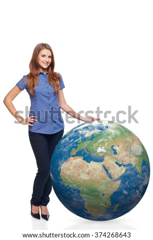 Smiling beautiful woman in full length standing with earth globe, Africa and Europe in front, over white background