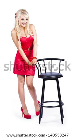 Smiling Blond Girl Looking Nervous In Red Dress While