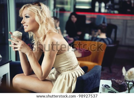 Smiling blonde beauty in a coffee shop