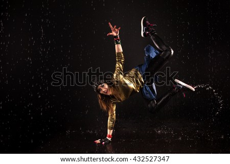 smiling bright girl in hip-hop style standing on arm. aqua studio