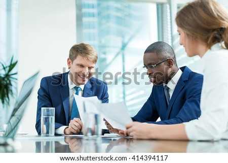 Smiling business people in office