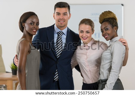 Smiling business team standing together at office