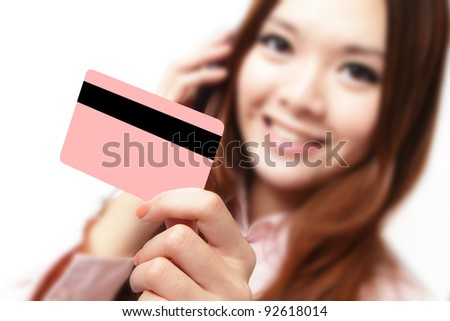 Smiling business woman holding a credit card and speaking mobile phone! isolated on white background, model is a asian beauty