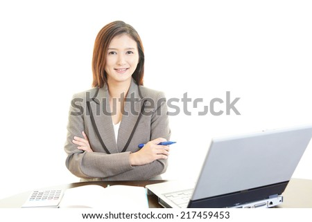 Smiling business woman using laptop