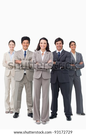 Smiling businessteam standing with arms folded against a white background