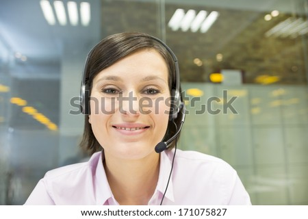 Smiling Businesswoman in the office on video conference, headset, point of view