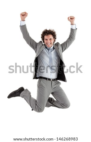 Smiling Caucasian businessman jumping for joy.