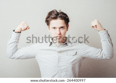 Smiling cheerful guy showing fists with playful attitude