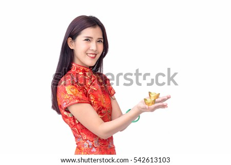 Smiling Chinese woman holding gold ingots for chinese new year