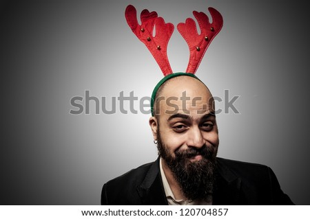 smiling christmas bearded man with funny expressions on grey background