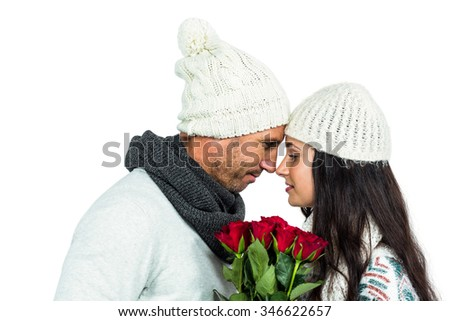 Smiling couple nose-to-nose holding roses bouquet on white screen