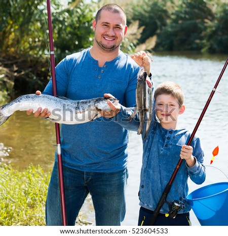 Portrait father son fishing rods summer stock photo for Father son fishing