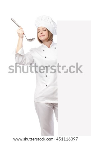 smiling female chef, cook or baker with ladle enjoying food behind banner with empty copy space for you text isolated on white background. advertisement blank board. your text here