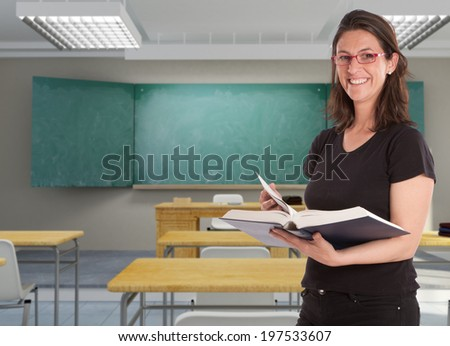 Smiling female teacher in a school classroom