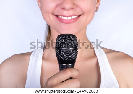 smiling girl with microphone