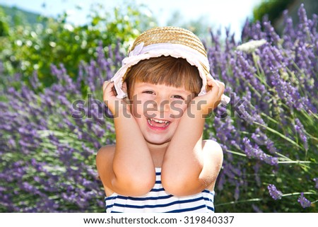 smiling girl with straw hat in lavender field