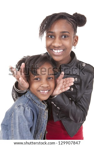 smiling girls posing on white background