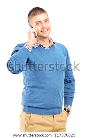 Smiling guy talking on a mobile phone isolated on white background