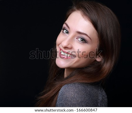 Smiling happy woman looking on black background