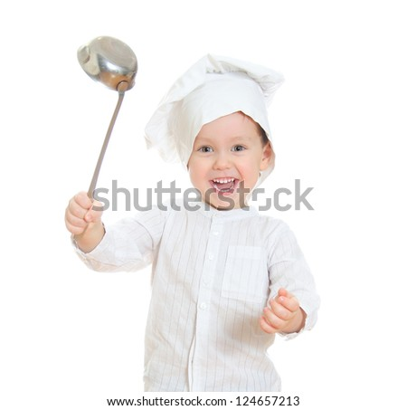 Smiling little boy in chef's hat holding ladle. Isolated on white