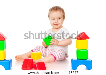Smiling little girl with blocks, isolated on white