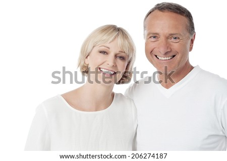 Smiling loving couple standing on white background