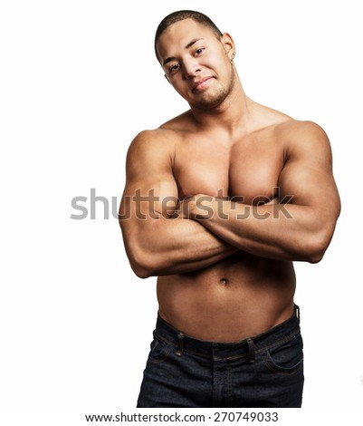 Smiling man with naked muscular torso. Isolated on white