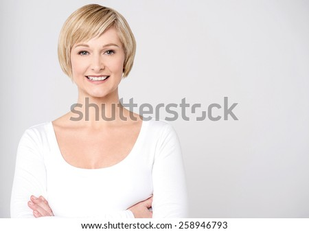 Smiling mid woman posing with folded arms
