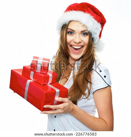 Smiling model posing in studio with gifts. Beautiful Santa Girl. Isolated white background.
