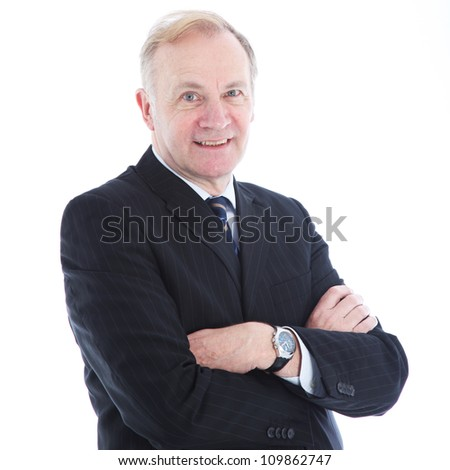 Smiling senior businessman with his arms folded across his chest isolated on white