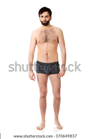 Smiling shirtless man.